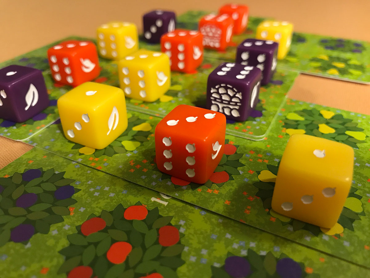The Tiny Fruit Icons on the Dice Score Trackers in Orchard