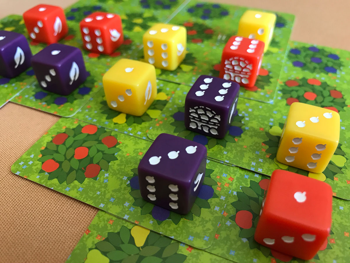 A Tantalizing Display of Fruit Dice in Orchard: A 9 Card Solitaire Game