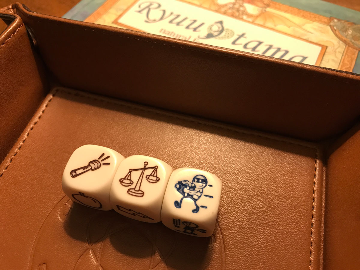 Rolling a Trio of Rory's Story Cubes to Build the Map in Beak, Feather, and Bone