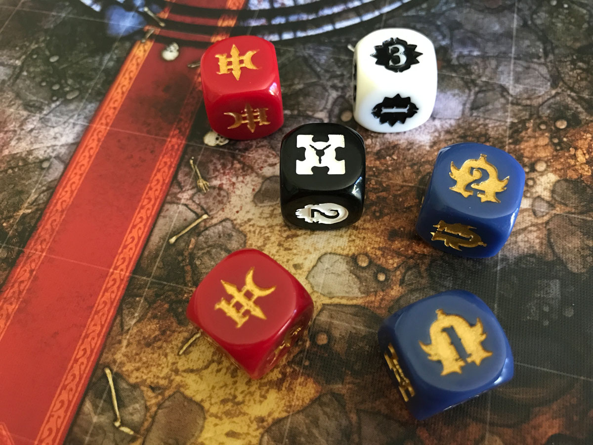 A Slight Struggle to Read the Faces on the Attack Dice from Journey: Wrath of Demons