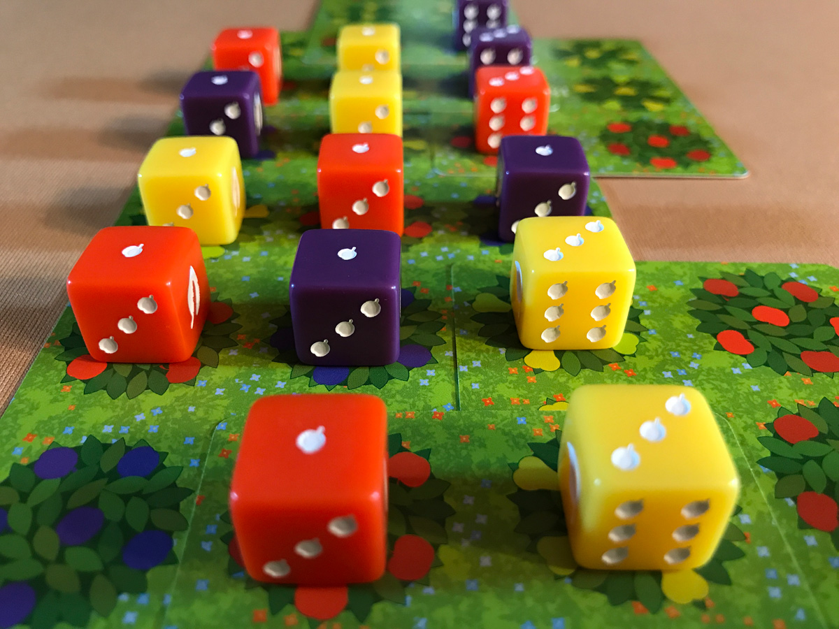 Fruit Trees and Dice All in a Neat Configuration in Orchard: A 9 Card Solitaire Game