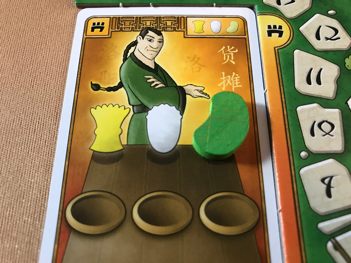 A Helpful Merchant Pointing at the Desired Vegetable in At the Gates of Loyang